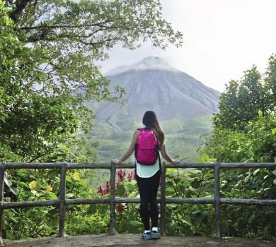 Girl facing volcano
