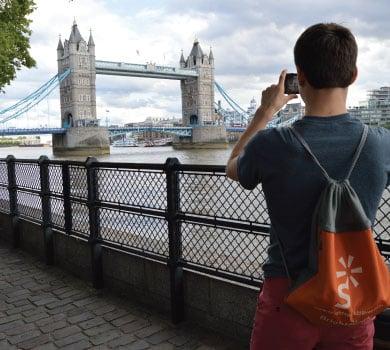 student taking photo at London's Tower Bridge