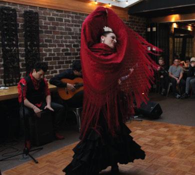 flamenco dancer and musicians